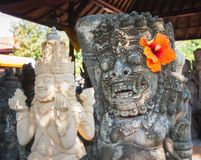 Stone Statues, Denpasar, Bali, Indonesia. Balinese God Carved Stone Statue, Denpasar, Bali, Indonesia stock photo