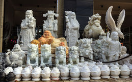 Stone statues on display for sale at a traditional village . stock photography