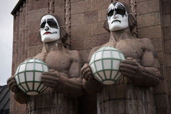 Stone statues at the Helsinki Railway Station wearing Kiss masks on May Day 2017. Stock Image