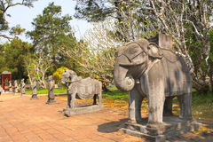 Stone statues of horse, elephant and people in Minh Mang Tomb, H Royalty Free Stock Photo