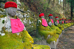 Stone statues in Japan. Old mossy stone statues of Jizo in Nikko, Japan Royalty Free Stock Photography