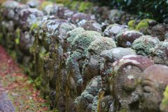The stone of statues at rain day. The Otagi Nenbutsu ji Temple, Kyoto, Japan Royalty Free Stock Image