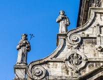 Stone statues of saints monks on the roof of the church Bernardine in Lviv, Ukraine Royalty Free Stock Photo