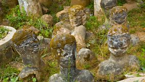 Stone statues stick up from ground  in Buddha park also known as Xieng Khuan sculpture park Stock Image