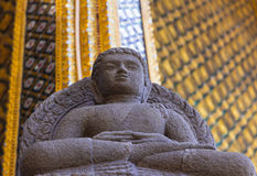 Stone staues. Statue made of stone in the temple of the Emerald Buddha in Thailand Royalty Free Stock Photography
