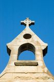 Stone Steeple. A view of an old steeple of stonework on an Anglican Church with a very bright blue sky as a background Royalty Free Stock Photography