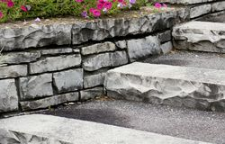 Stone Steps. With pansy flowers on top of wall stock image