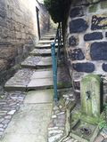 Stone steps in alley way with railing from seaside town uk stock image