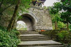 Stone steps before ancient Chinese gate on mountaintop in aftern Royalty Free Stock Photography
