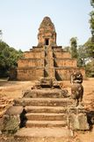 Angkor Wat Temples area in Siem Reap Cambodia. Stone steps by animal statue with ancient temple on the background in Angkor Wat site in Siem Reap, Cambodia royalty free stock photo