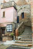 Stone steps with Buildings. Stone staircase among brick and plaster old buildings Stock Photography