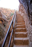 Stone steps carved into cliff face. Red stone stairway steps carved into solid rock cliff face Stock Images