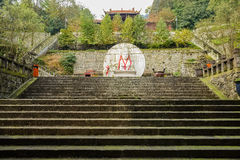 Stone steps and Chinese buddha on mountainside in sunny afternoo Stock Photography