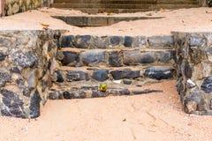 Stone steps close-up on a sandy beach Stock Photos
