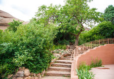 Stone Steps Curving by Green Trees Royalty Free Stock Photos