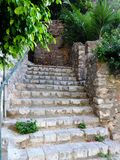 Stone Steps in Greek Village. Stone steps in a public footpath or walkway in a Greek village Royalty Free Stock Photography