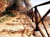 Stone steps and hand trail royalty free stock photography