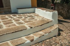 Stone steps on house facade with whitewashed wall royalty free stock photography
