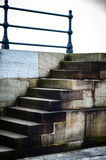 Stone steps and iron rail Stock Photography