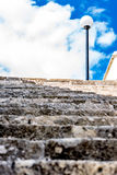 Stone steps and lamp post. Royalty Free Stock Image