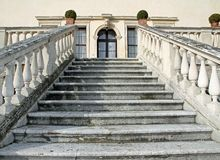 Stone steps leading to the entrance of the prestigious Italian V Stock Photo