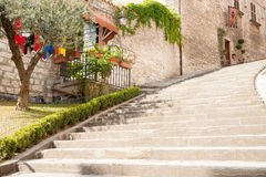 Stone steps leading up beside building. Royalty Free Stock Image