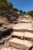 Stone steps, leading up, on a tourist track in the mountains of Royalty Free Stock Photo