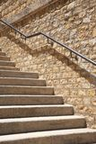 Stone steps with metal banister Royalty Free Stock Images