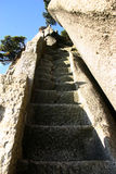 Stone steps on mountainside. Low angle view of stone steps cut into rocky mountainside Royalty Free Stock Photo