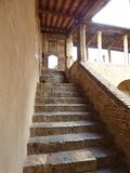 Stone steps rising to a covered passage stock photos