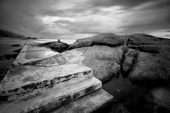 Stone steps with rocks at the ocean Royalty Free Stock Images