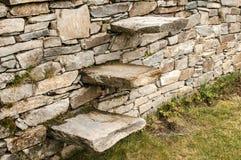 Stone steps into stonewall Stock Image
