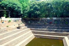 Stone steps of a Temple pond in India. Perfect rectangle stone steps of a man made pond in an Indian Temple at Nandi Hills near Bangalore India stock photos