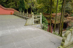Stone steps to entrance of flagstone paved yard with balustrades Stock Image