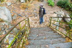 Stone steps and tourist in rain Stock Photos