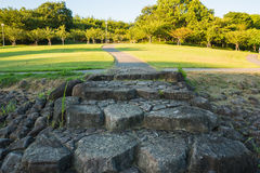 Stone steps and walkways in the garden. In the evening with a shiny of a tree royalty free stock images