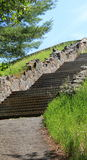 Stone Steps and wall leading upwards Stock Photo