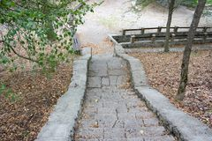 Stone steps in the woods on the monastery grounds Royalty Free Stock Photography