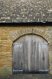 Stone storage shed. With slate roof and wooden doors Royalty Free Stock Photo