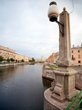Stone street-lamp on the old Pikalov bridge Stock Photos