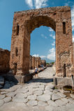 Stone street and remains of arc in Pompeii Italy. Pompei was des Stock Photo