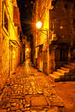 Stone street in Trogir, Croatia, night scene. Stone street in Trogir, Croatia, Unesco, night scene. Travel destination. Beautiful place Royalty Free Stock Photo
