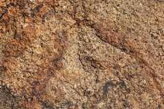 Stone structure. Structure of a stone of a brown granite with an impregnation Stock Images