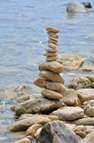 Stone structure on rocky shore Stock Photography