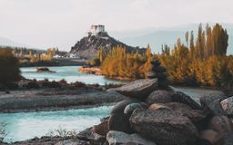 Stone stupa foreground with Stakna Gompa and Indus river before sunset with cloudy sky and mountains Royalty Free Stock Photography