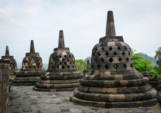 The temple of Borobudur on Java in Indonesia. Stone stupas of Borobudur Temple at early morning on Java, Indonesia. Borobudur, in Java, Indonesia, is one of the Royalty Free Stock Images