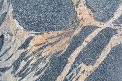 Stone surface. Striped gray granite stone surface Stock Photos