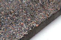 Stone surface with marble chips. View off the edges of the slab Stock Photos