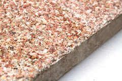 Stone surface with marble chips. View off the edges of the slab Royalty Free Stock Photo