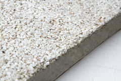 Stone surface with marble chips. View off the edges of the slab Royalty Free Stock Photography